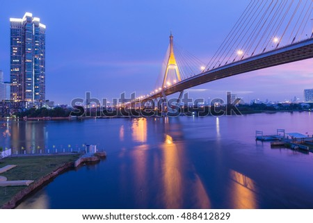 Suspension bridge cross Bangkok river with twilight sky background