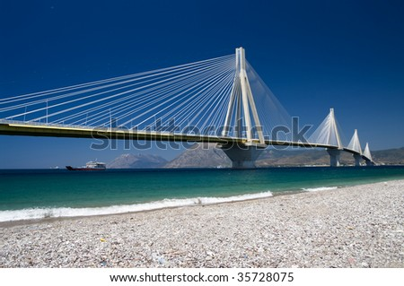 suspension bridge crossing Corinth Gulf strait, Greece.  Its official name is the Charilaos Trikoupis Bridge. The lead architect was Berdj Mikaelian. Is the world's second longest cable-stayed deck; - stock photo