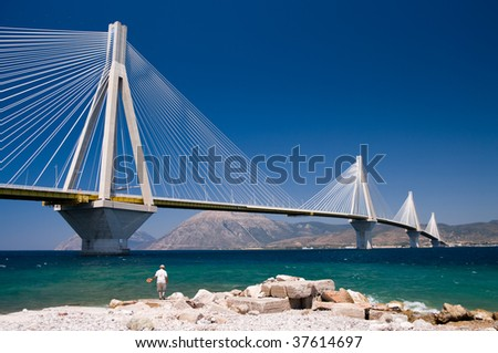 suspension bridge crossing Corinth Gulf strait, Greece.  The lead architect was Berdj Mikaelian. Is the world's second longest cable-stayed deck; - stock photo