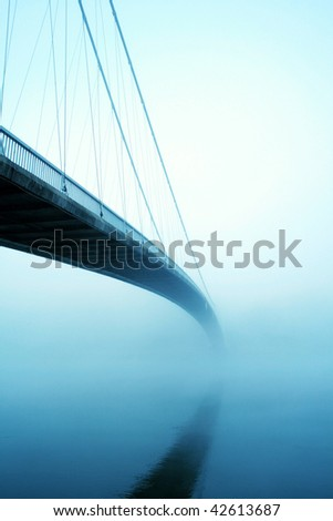 Suspension bridge in fog