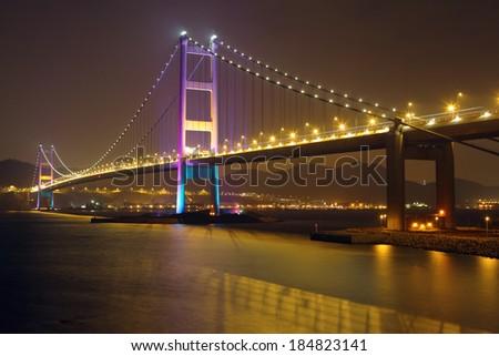 Suspension bridge in Hong Kong at night - stock photo