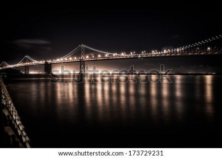 Suspension bridge lit up at night, Bay Bridge, San Francisco Bay, San Francisco, California, USA
