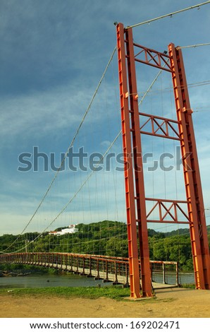 Suspension Bridge on the beach in San Juan del Sur - stock photo