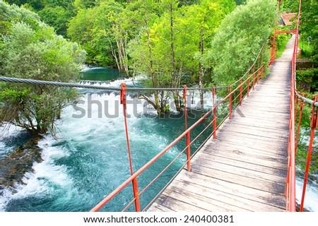 Suspension bridge over the river. Martin Brod, Bosnia and Herzegovina - stock photo