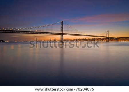 Suspension bridge over the Tagus river in Lisbon - stock photo