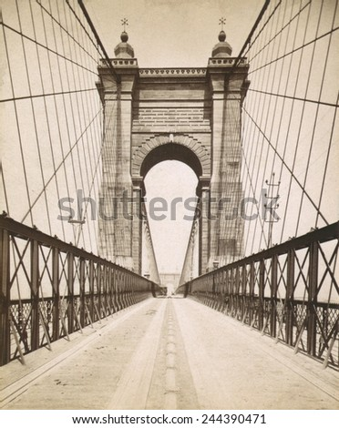 Suspension Bridge spanning the Ohio River at Cincinnati was engineered and built by John A. Roebling. Opened in 1866 it was then the World's longest bridge. - stock photo