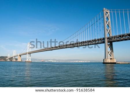 Suspension Oakland Bay Bridge in San Francisco to Yerba Buena Island with downtown - stock photo