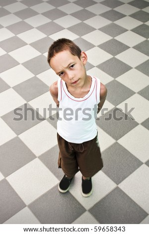 suspicious boy standing alone over black and white background