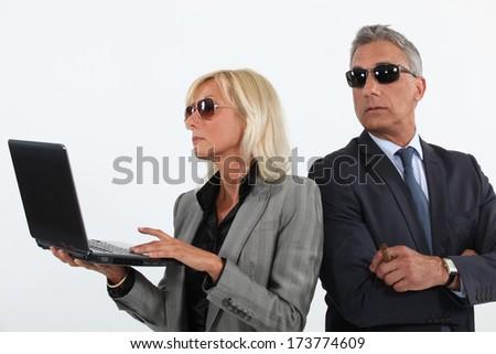 Suspicious business partners - stock photo