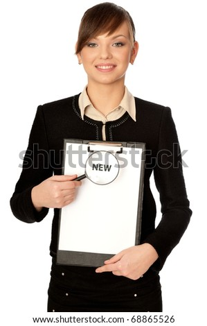 Suspicious detailed consideration of a novelty in search of dirty tricks - stock photo