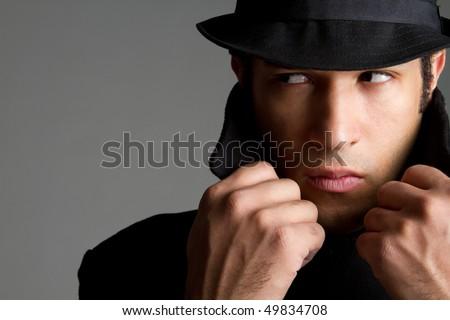Suspicious Young Man - stock photo