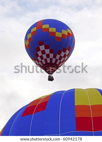 SUSSEX, CANADA - SEPTEMBER 12: Two hot air balloons launch at the 2010 Atlantic International Balloon Fiesta on September 12, 2010 in Sussex, Canada.