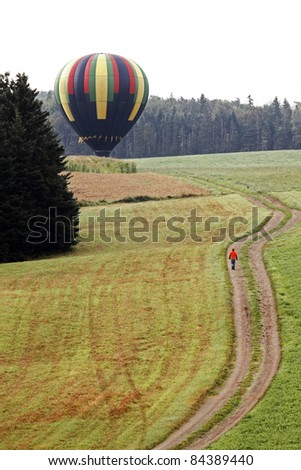 SUSSEX, CANADA - SEPTEMBER 9: Wind Spirit (Joel Jones - Seale, Alabama) lands in a field at the Atlantic International Balloon Fiesta on September 9, 2011 in Sussex, Canada.