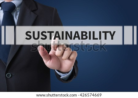 SUSTAINABILITY Businessman hands touching on virtual screen and blurred city background - stock photo