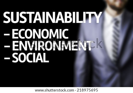 Sustainability Descriptions  written on a board with a business man on background - stock photo