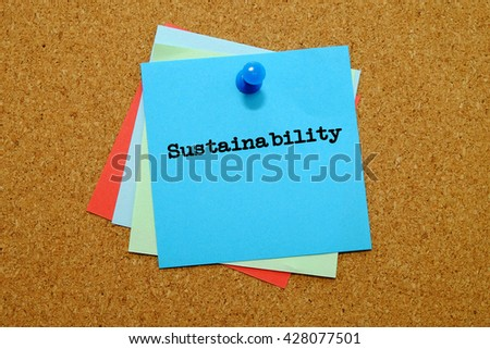 Sustainability written on colored sticker notes over cork board background. - stock photo