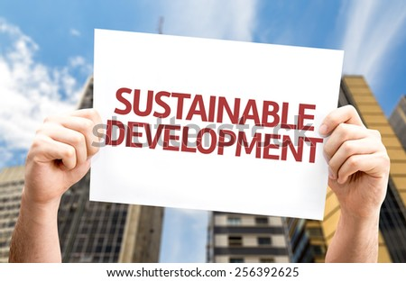 Sustainable Development card with urban background - stock photo