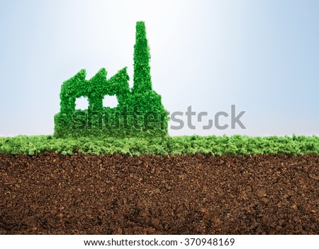 Sustainable industrial development concept with grass growing in shape of factory  - stock photo