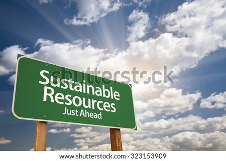 Sustainable Resources Green Road Sign With Dramatic Clouds and Sky.