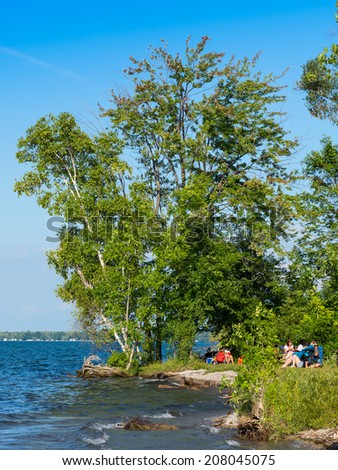 SUTTON, ONTARIO - July 27, 2014: Vacationers relaxing in Sibbald Provincial Park on Lake Simcoe in Ontario located about an hour north of Toronto - stock photo