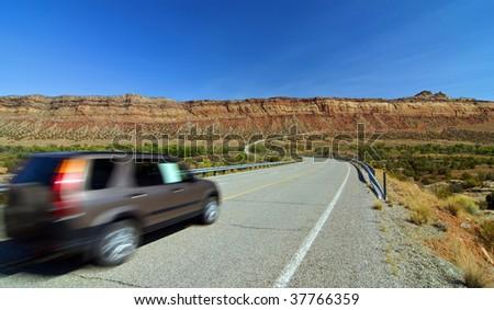 SUV car entering monument valley, utah - stock photo