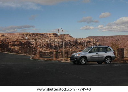 Suv parked near canyon ready to begin the adventure - stock photo
