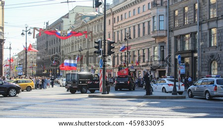 SUVs with festive flags on Nevsky Prospekt. St. Petersburg, Russia - 9 May, 2016. Celebration day of victory in the center of St. Petersburg.