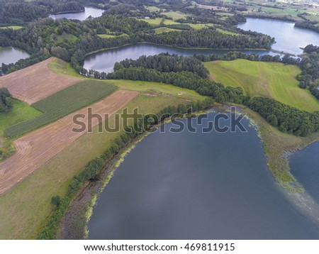 Suwalki Landscape Park, Poland. Summer time blue lakes and whites clouds. View from above.