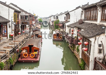 SUZHON, JIANGSU/CHINA-APR 11: Suzhou old town canals and folk houses on Apr 11,2015 in Suzhou, Jiangsu, China. Taken on the Shantang old street in Suzhou. Suzhou is one of the old watertowns in China. - stock photo