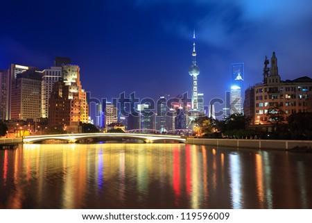 suzhou river at night in shanghai with beautiful lujiazui financial center - stock photo