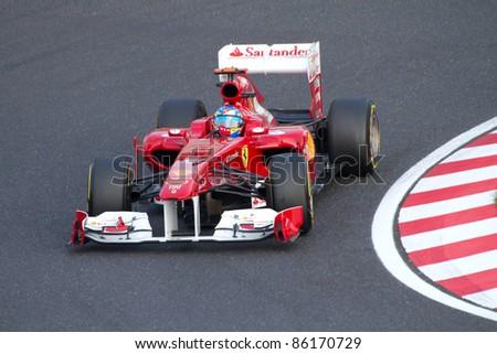 SUZUKA, JAPAN - OCTOBER 7 : Fernando Alonso of Ferrari during free practice at 2011 Formula 1 Japanese Grand Prix on October 7, 2011 in Suzuka, Japan. - stock photo