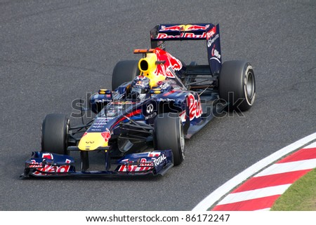 SUZUKA, JAPAN - OCTOBER 7 : Sebastian Vettel of Red Bull Racing during free practice at 2011 Formula 1 Japanese Grand Prix on October 7, 2011 in Suzuka, Japan. - stock photo