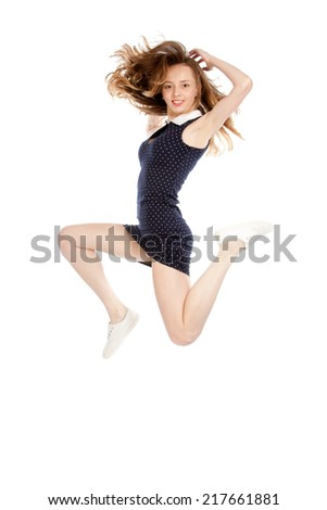 Svelte girl jumping and smiling, isolated