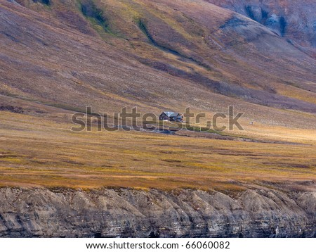 "Svenskhuset - ""The Swedish house"" is the first human settlement on Spitsbergen, now deserted. On the remote shores of Isfjorden, Svalbard, Spitsbergen, Norway. - stock photo"