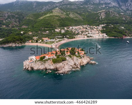 Sveti Stefan islet and luxury hotel (group of Aman Resorts), view from Adriatic sea at shoreline. Aerial shot. Montenegro
