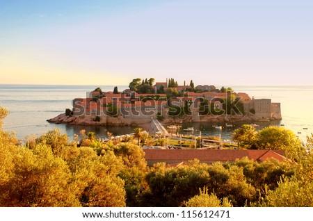 Sveti Stefan luxury island on sunset (Adriatic sea, Montenegro) - stock photo