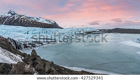 Svinafell Glacier in the evening at the sunset - stock photo