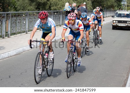 SVYATOGORSK, UKRAINE - SEPTEMBER 5, 2012: On the 3rd stage of the International Youth Friendship cycling, dedicated to the 69th anniversary of the liberation of Donbass from invaders.  - stock photo