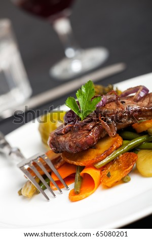 swabian steak with roasted onion rings - stock photo