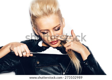 Swag girl in black leather jacket sniffing cocaine (imitation, flour). White background, not isolated - stock photo