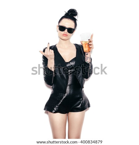 swag girl in sunglasses and black leather jacket  drinking beer - stock photo