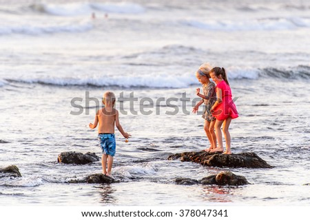 SWAKOPMUND, NAMIBIA - JAN 5, 2016: Unidentified children play on the Atlantic coast of Swakopmund. It was found in 1892 as the main harbour for German South-West Africa