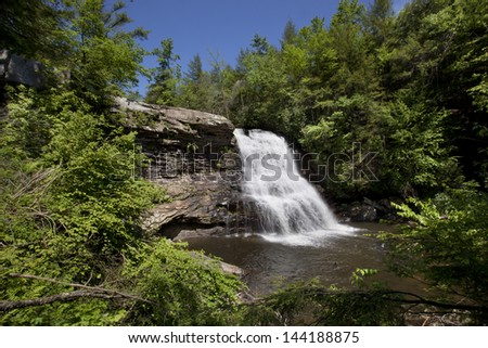 Swallow Falls State Park encompasses the Youghiogheny River and is home of Muddy Creek Falls.  This spectacular waterfall is 53 feet high and it is the highest in Maryland. - stock photo