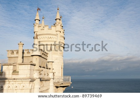 Swallow's Nest Castle tower, Crimea, Ukraine, with blue sky and sea on background - stock photo