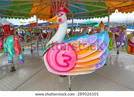 swan on a carnival Merry Go Round in temple fair - stock photo