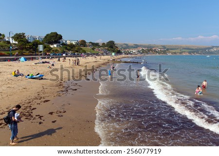 SWANAGE, DORSET, ENGLAND-SEPTEMBER 3  2014: Sunny weather brought families and visitors to Swanage on the Dorset coast to enjoy the beach waves and summer sunshine on Wednesday 3rd September 2014