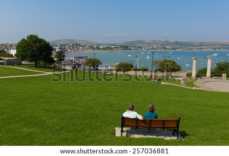 SWANAGE, DORSET, ENGLAND-SEPTEMBER 3  2014: Sunshine and warm summer weather brought visitors to Swanage on the Dorset coast to enjoy this popular seaside town on Wednesday 3rd September 2014  - stock photo