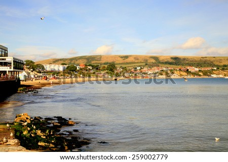 SWANAGE, DORSET, UK. OCTOBER 03, 2014.  A view across the bay in October at Swanage, Dorset, UK. - stock photo