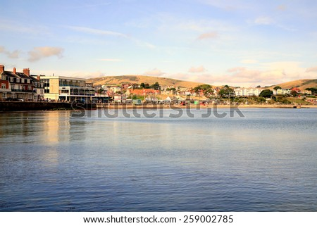 SWANAGE, DORSET, UK. OCTOBER 03, 2014. A view across the bay towards the town at Swanage, Dorset, UK. - stock photo