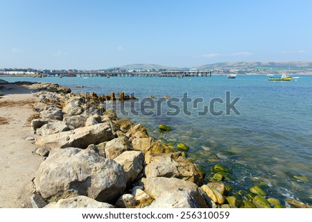 Swanage harbour and jetty Dorset England UK with blue sea and sky on a beautiful summer day on the English Jurassic coast - stock photo